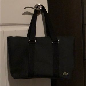 Lacoste black tote with pouch.